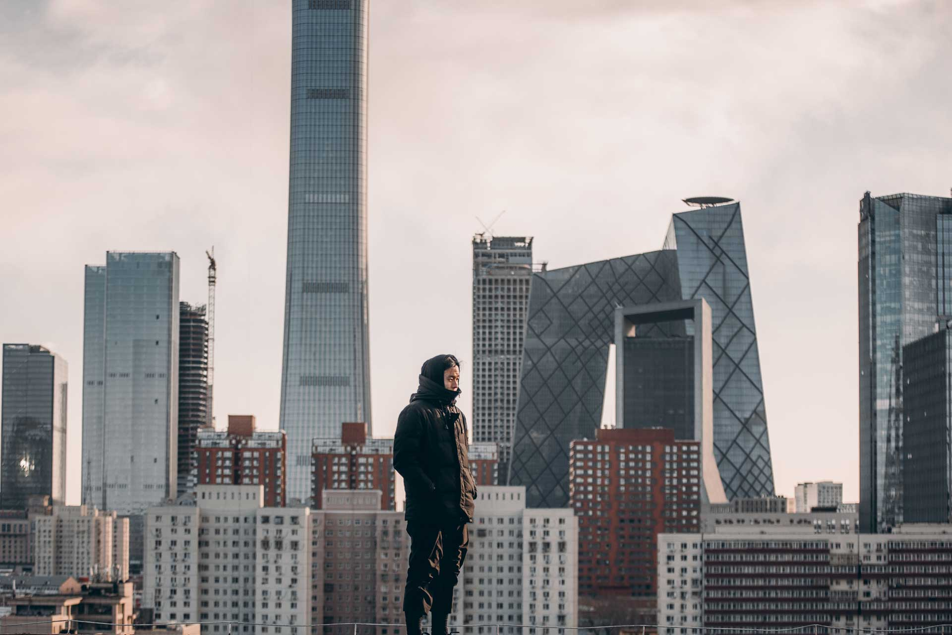 Man looking over the rooftops of Beijing