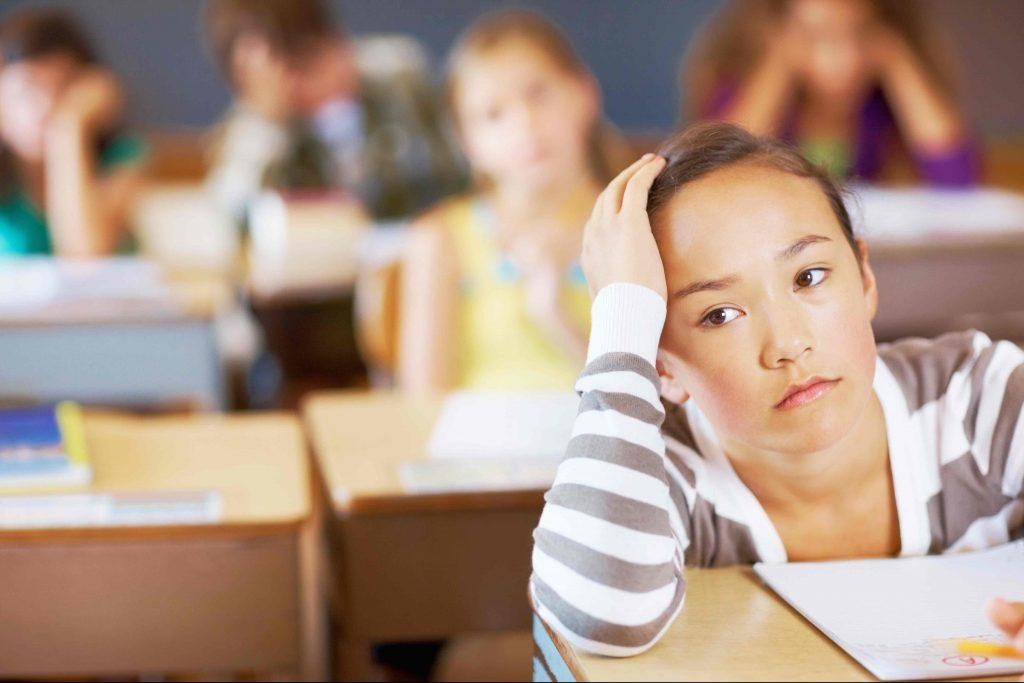 Bored girl sitting in class