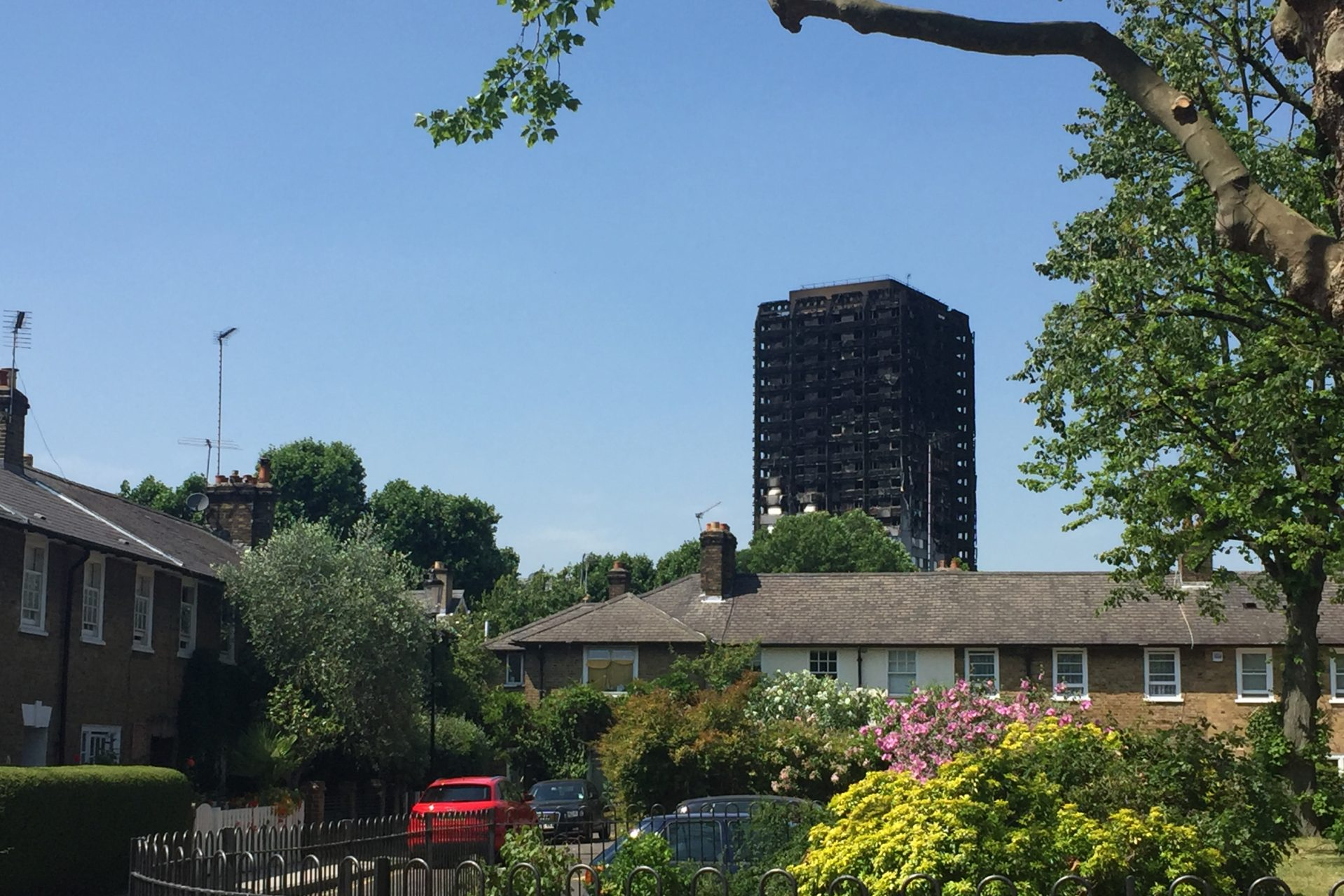 Picture of Grenfell Tower in the distance with houses in the forefront