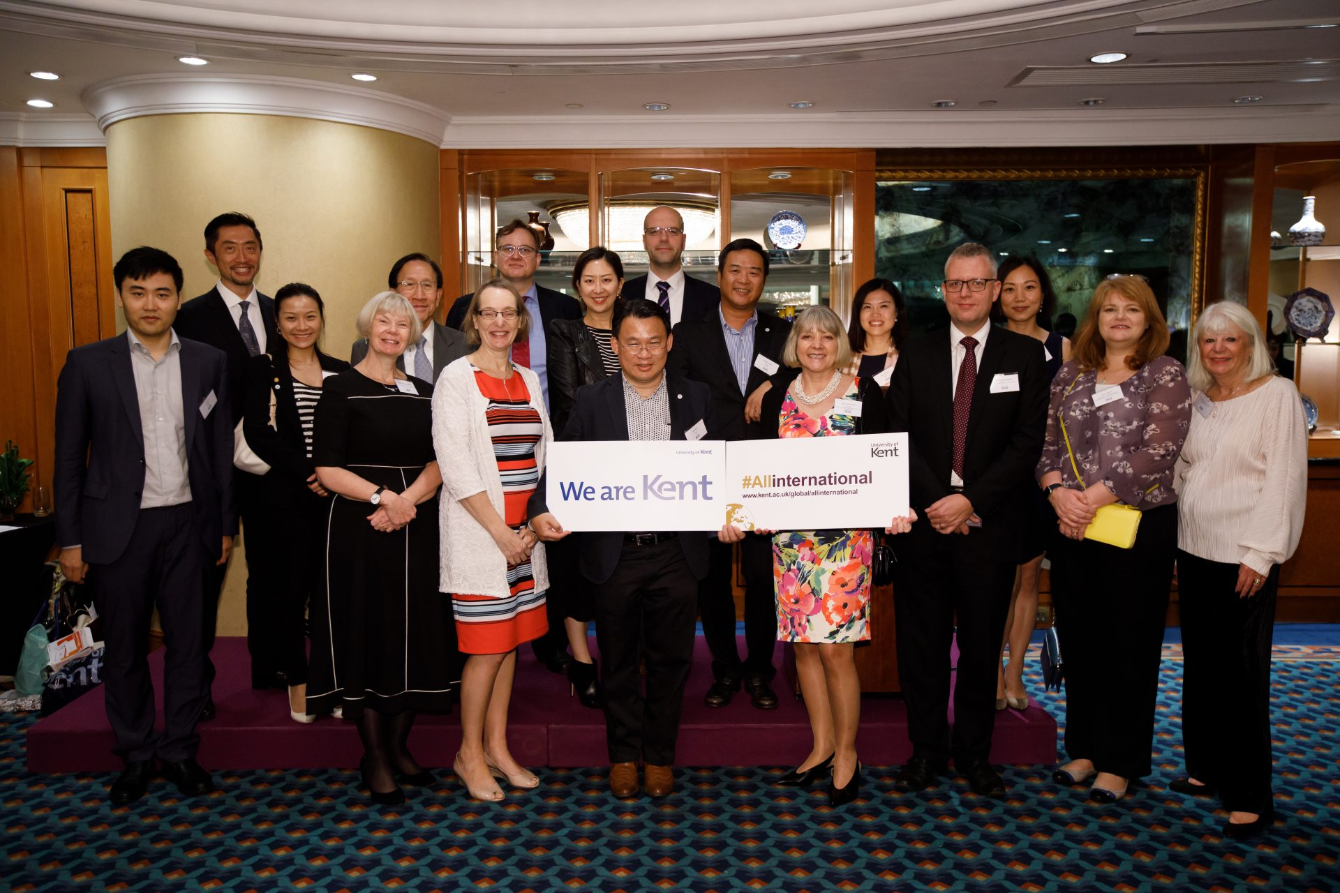 Kent and HKBU attendees celebrating their partnership in a group photo