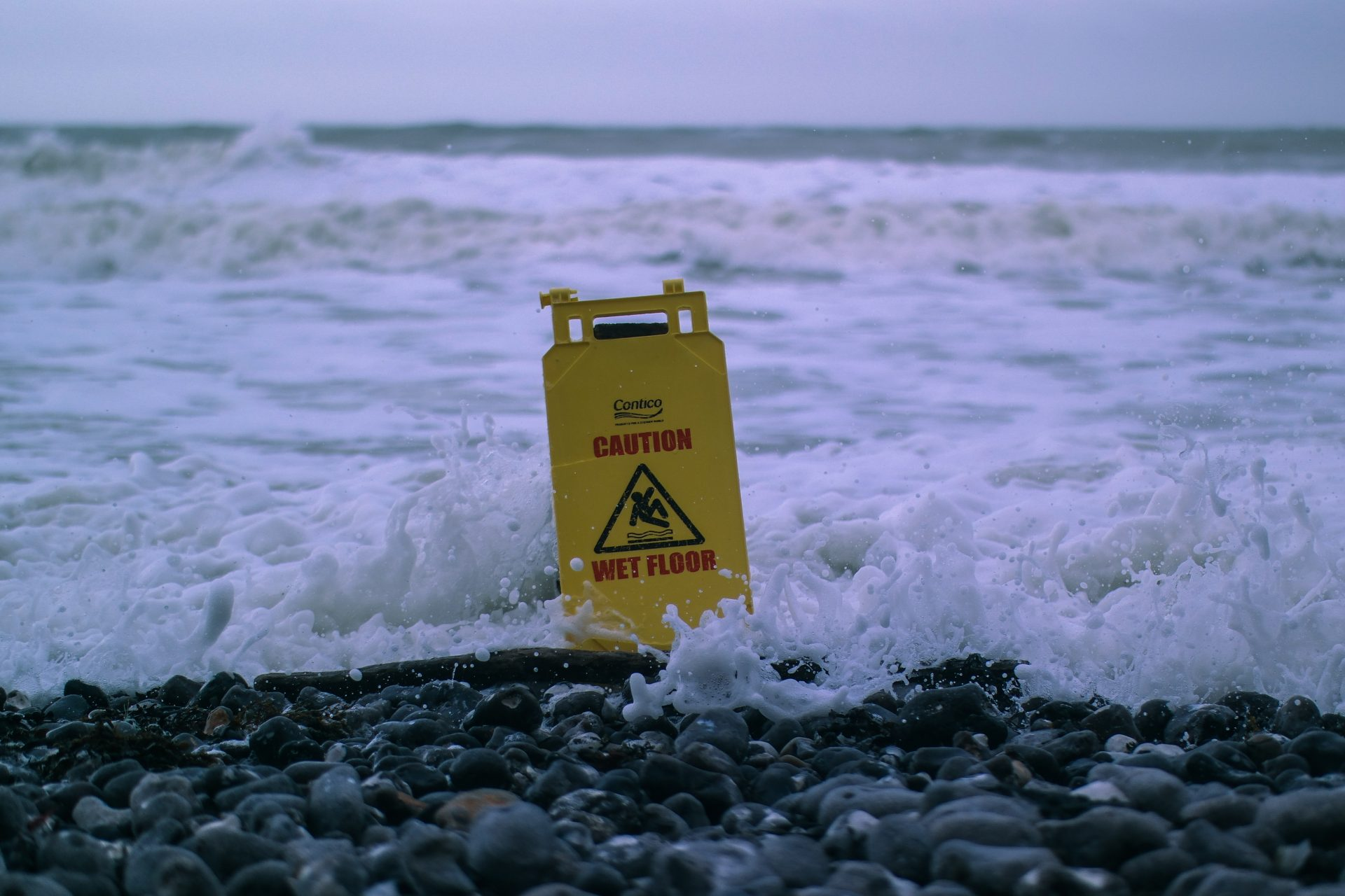 Wet floor sign in the sea