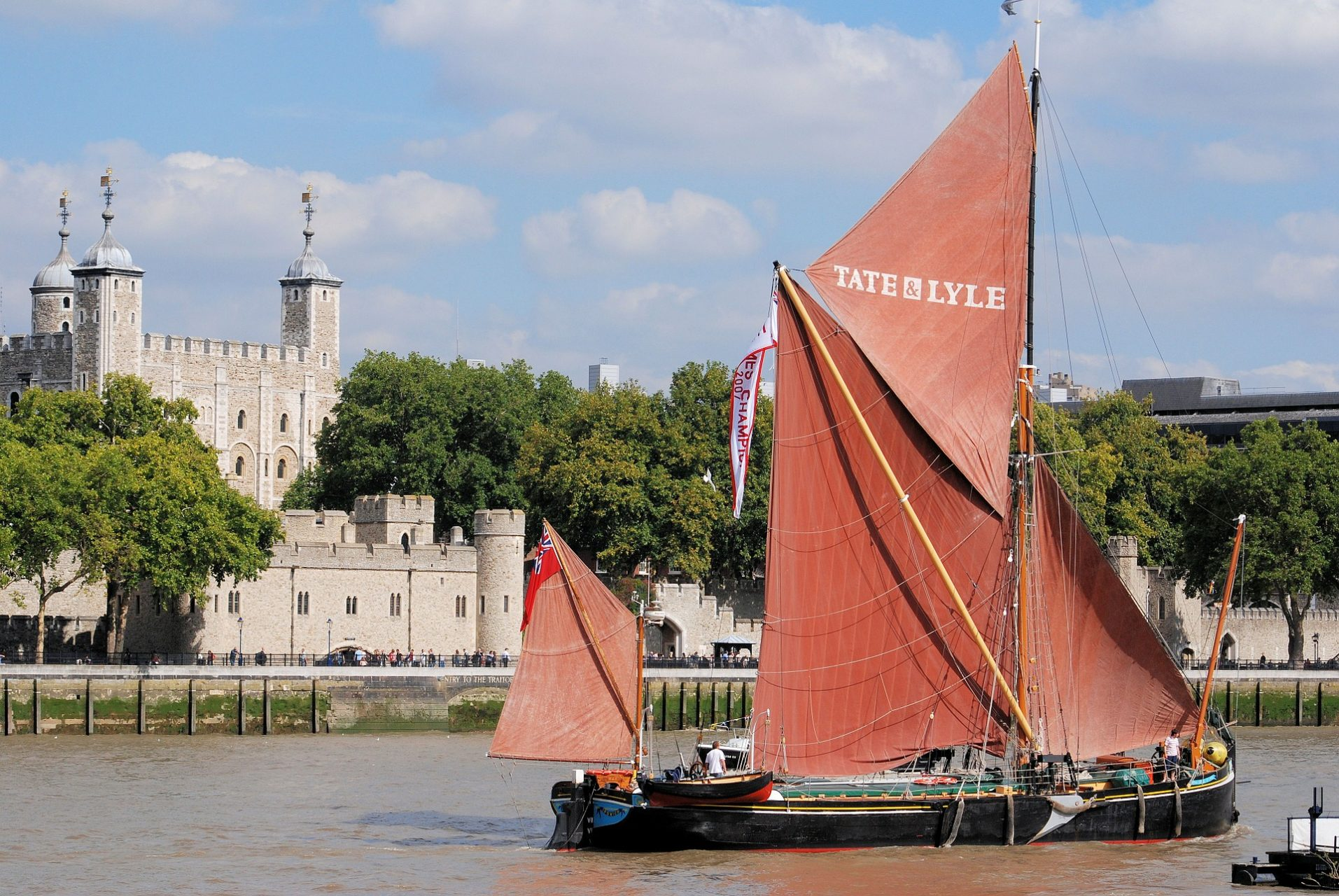 Thames sailing barge sailing past the tower of London