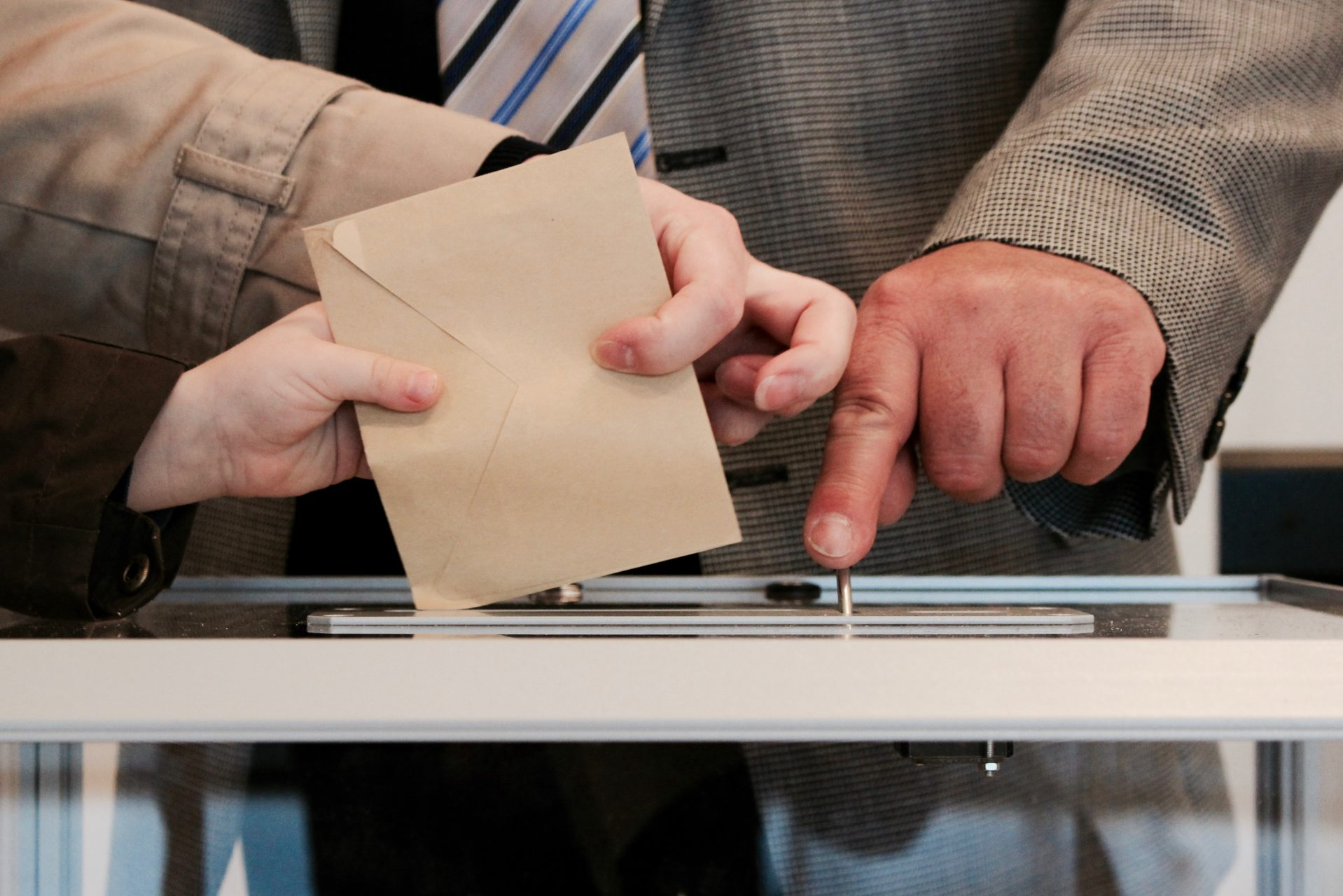 Hands of a man casting a vote