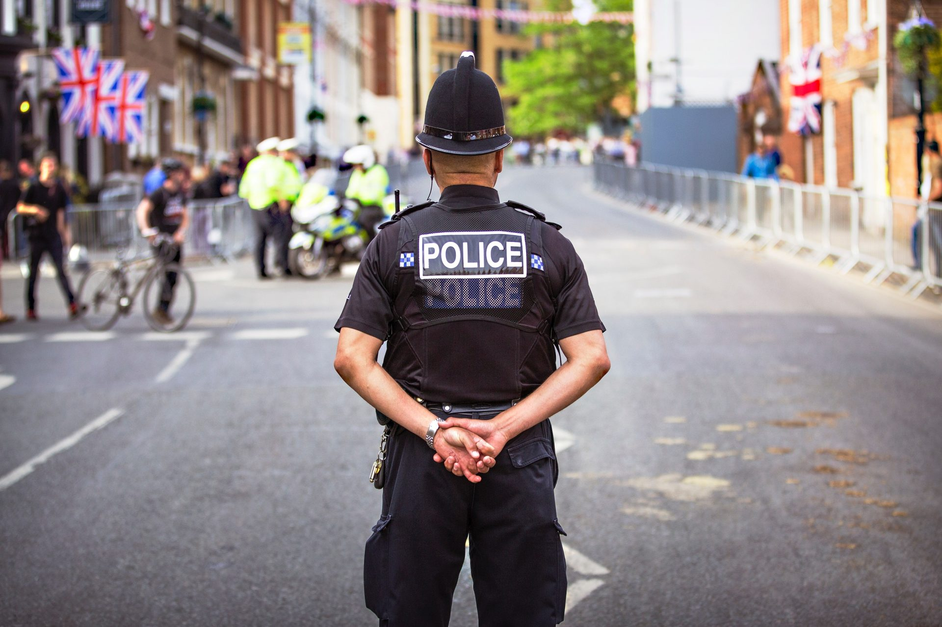 A UK Policeman standing in a street